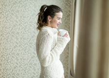 Pretty young woman with cup of coffee Stock Images