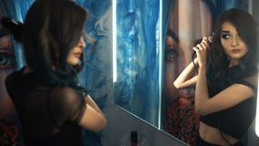 Pretty, young woman curling her hair in front of her bathroom mirror. Hair perm. Shower Curtains with Art painting. stock footage