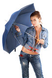 Pretty young woman in a denim suit Stock Images