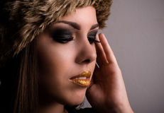 Pretty young woman displaying her eye makeup Stock Image