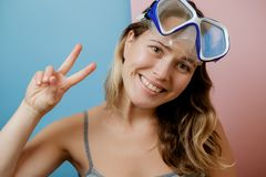 Pretty young woman in diving mask against pink background. Summe. R concept Royalty Free Stock Photos