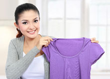 Laundry at home. Pretty young woman doing the laundry at home stock image