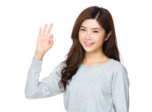 Pretty young woman doing the ok sign Stock Image