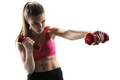 Pretty young woman doing push exercise with a dumbbell as a part of a fitness workout Royalty Free Stock Photo