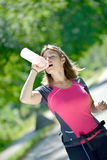 Pretty young woman doing skate is refreshed. With water Stock Photography