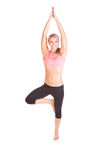 A pretty young woman doing yoga exercise Stock Photo