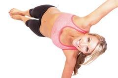 A pretty young woman doing yoga exercise. Portrait of pretty young woman doing yoga exercise Stock Photos