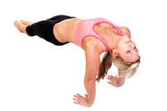 A pretty young woman doing yoga exercise. Portrait of pretty young woman doing yoga exercise Stock Image
