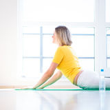 Pretty young woman doing YOGA exercise. At home Stock Photos