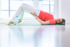 Pretty young woman doing YOGA exercise Royalty Free Stock Photos