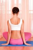 Pretty young woman doing yoga exercise on mat Royalty Free Stock Photo