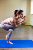 Pretty young woman doing yoga exercise. On mat Royalty Free Stock Images