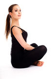 Pretty young woman doing yoga exercise Royalty Free Stock Photography