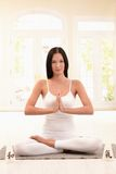 Pretty young woman doing yoga meditation Stock Images