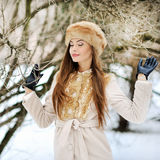 Pretty young woman dreaming in a forest. Outdoor Stock Photos