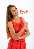 Pretty young woman dreaming of her sweetheart Stock Photography