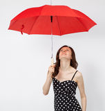 Pretty young woman in dress with open umbrella Stock Photography