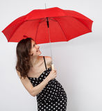 Pretty young woman in dress with open umbrella Royalty Free Stock Images