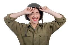 Pretty young woman dressed in american ww2 military uniform with M1 helmet stock photography