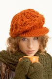 Pretty young woman dressed up warm drinking tea Stock Image