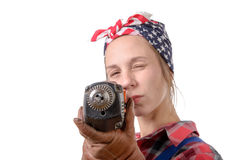 Pretty young woman with a drill on the white background Stock Photography