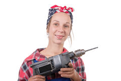 Pretty young woman with a drill on the white background Royalty Free Stock Photography