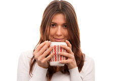 Pretty young woman drinking coffee Stock Photos