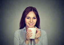 Pretty young woman drinking coffee Royalty Free Stock Photos