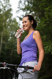 Pretty young woman drinks water Stock Image