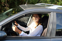 Pretty young woman driver Stock Image
