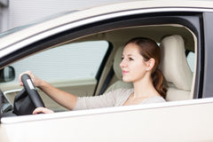 Pretty young woman driving Royalty Free Stock Image