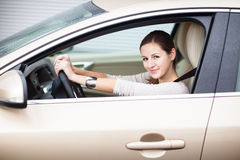 Pretty young woman driving her brand new car Stock Photography