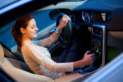 Pretty young woman driving her brand new car Royalty Free Stock Photos