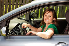 Pretty young woman driving  her car Stock Photos