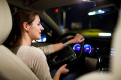 Pretty, young woman driving her modern car Stock Image