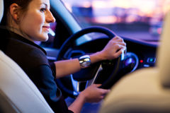 Pretty, young woman driving her modern car Royalty Free Stock Images