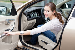 Pretty young woman driving her  new car Royalty Free Stock Images