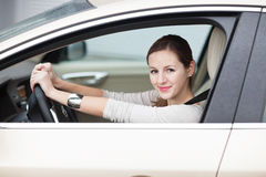 Pretty young woman driving her  new car Stock Images