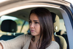 Pretty young woman driving her new car Stock Photo
