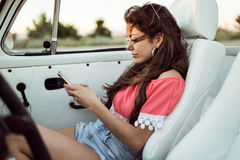 Pretty young woman driving on road trip on beautiful summer day. Royalty Free Stock Photos