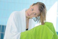 Pretty young woman drying hair with towel royalty free stock images
