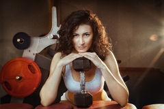 Pretty Young Woman with dumbbell in a Health Club Stock Photo