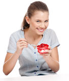 Pretty young woman eating cake. Isolated Stock Image