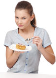Pretty young woman eating cake. Isolated Royalty Free Stock Photography