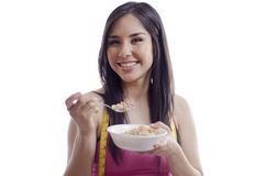 Pretty young woman eating cereal Royalty Free Stock Images