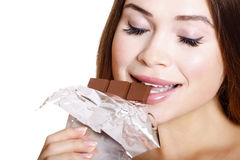Pretty young woman eating chocolate Stock Photo