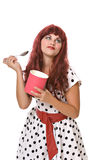 Pretty young woman eating ice cream. Pretty young woman in a wig eats ice cream isolated against white background Royalty Free Stock Photo