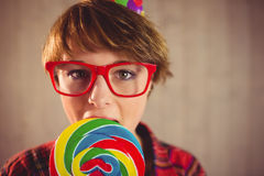 Pretty young woman eating lollipop Stock Images