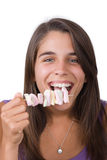 Pretty young woman eating marshmallows Royalty Free Stock Photos
