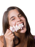 Pretty young woman eating marshmallows Royalty Free Stock Images